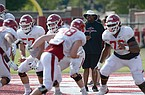 Arkansas assistant coach Brad Davis directs his players Tuesday, Sept. 8, 2020, during practice at the university football practice fields in Fayetteville.