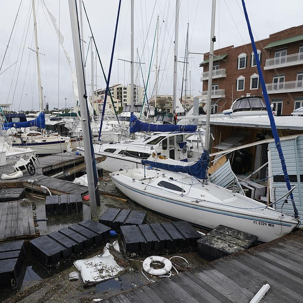 Boats sit in a jumbled mess Thursday at a marina in Pensacola, Fla., in the wake of Hurricane Sally's landfall a day earlier. Flooding from the storm remained a threat from Alabama to Georgia and the Carolinas as forecasters turned their attention to two more tropical systems brewing in the busiest Atlantic hurricane season on record. More photos at arkansasonline.com/918sally/. (AP/Gerald Herbert)