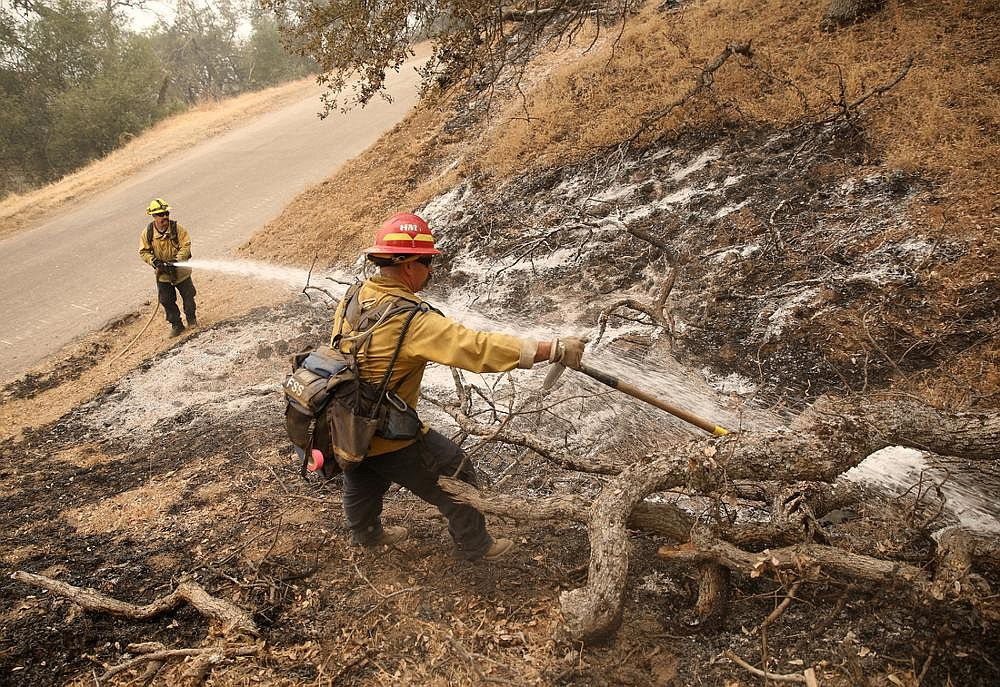 Firefighters put out a hot spot Thursday in the Sequoia National Forest in central California, where a wildfire is only 12% contained, officials said.