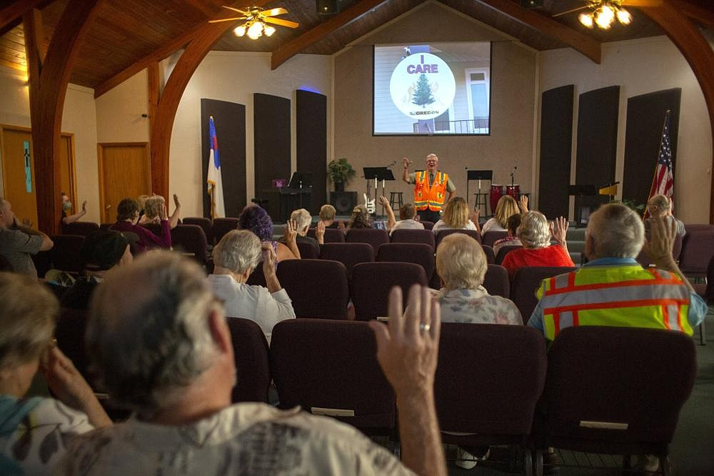 Pastor Lee Gregory delivers his first sermon since the Almeda Fire swept through nearby towns, leaving 10 of his parishioners homeless, in Medford, Ore., on Sunday. (The New York Times/Alisha Jucevic)