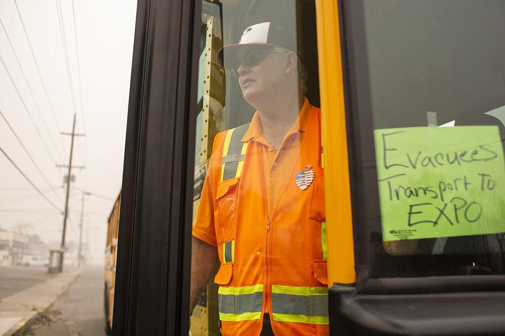 Lee Gregory, a local pastor and school-bus driver in Phoenix, Ore., is helping residents in his town, which was devastated by the Almeda Fire. In the span of a few hours on Sept. 8, the fire burned through large parts of not only Phoenix but the neighboring town of Talent. (The New York Times/Alisha Jucevic)