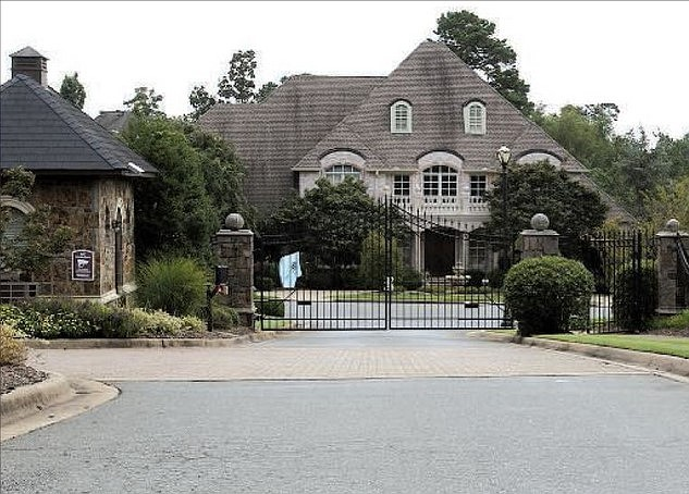 40 Germay Court -- Owned by Paula T. and Steven L. Bell, a house behind this gate was sold to Joann M. and Jeffrey J. Hall for $880,000.