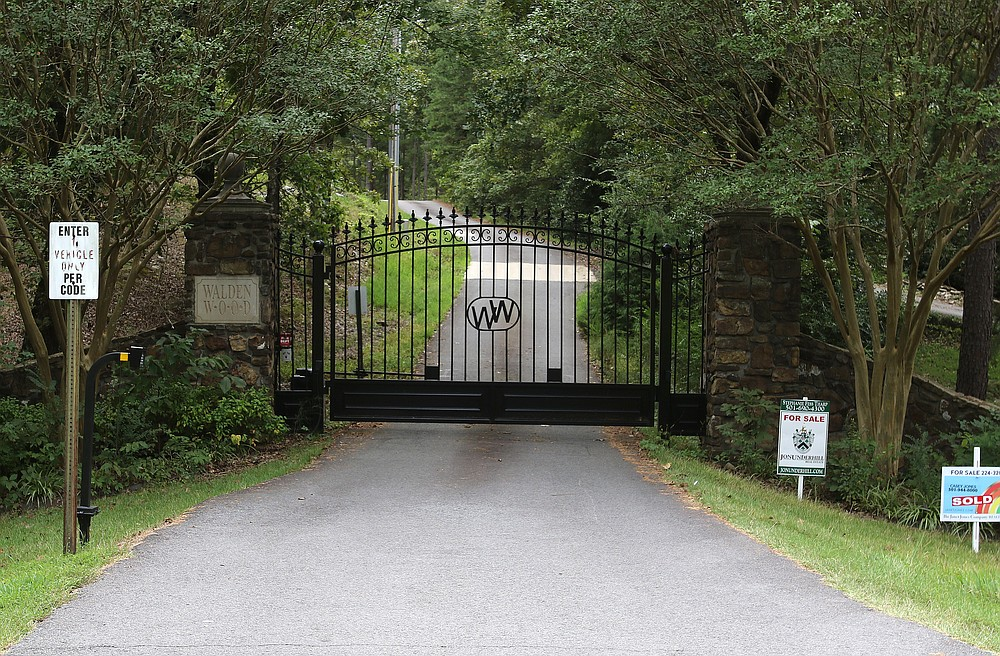 26 Waldenwood Lane -- Owned by Connie Wilkerson, a house behind this gate was sold to Mary and Arthur Cyrus for $1,035,000.