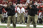 Georgia head coach Kirby Smart and offensive line coach Sam Pittman are shown during the Chick-fil-A Kickoff Game against North Carolina on Saturday, Sept. 3, 2016, in Atlanta. (Photo by Perry McIntyre Jr.)
