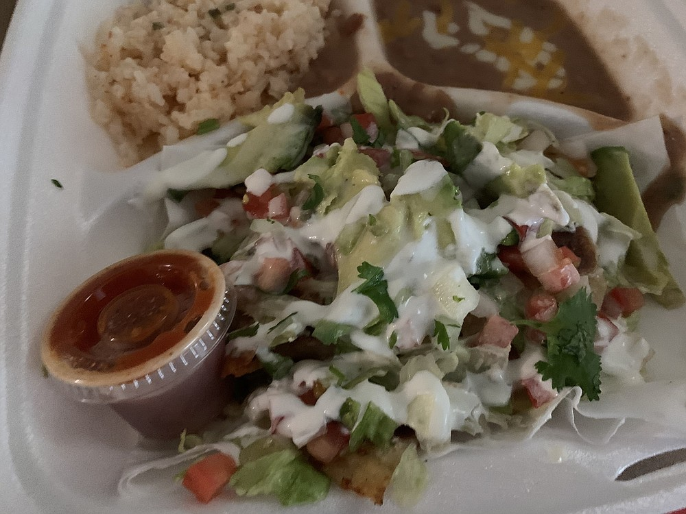 The side salad covers up the flautas from Lupita's Food Truck, but not the flavor. (Arkansas Democrat-Gazette/Eric E. Harrison)