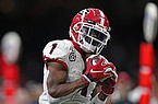 Georgia wide receiver George Pickens (1) pulls in a touchdown pass in the first half of the Sugar Bowl NCAA college football game against Baylor in New Orleans, Wednesday, Jan. 1, 2020. (AP Photo/Brett Duke)