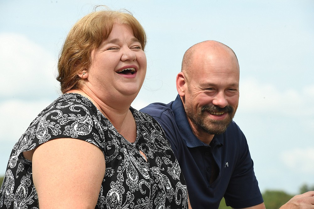 Angie and Mark Kattich laugh while talking about their large family Monday sept. 14, 2020.(NWA Democrat-Gazette/J.T.WAMPLER)