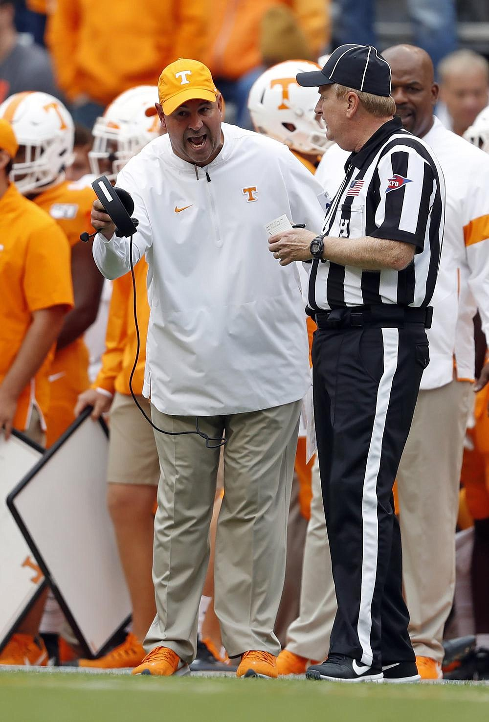 Tennessee Coach Jeremy Pruitt (left) received a two-year extension and a pay raise that will have him making $4.2 million in 2021. (AP file photo)