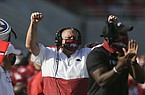 Arkansas coach Sam Pittman celebrates a big play during a game against Georgia on Saturday, Sept. 26, 2020, in Fayetteville.