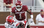 Arkansas safety Jalen Catalon (1) tackles Georgia receiver Kearis Jackson during a game Saturday, Sept. 26, 2020, in Fayetteville.
