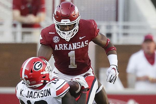 Arkansas safety Jalen Catalon (1) tackles Georgia receiver Kearis Jackson during a game Saturday, Sept. 26, 2020, in Fayetteville.