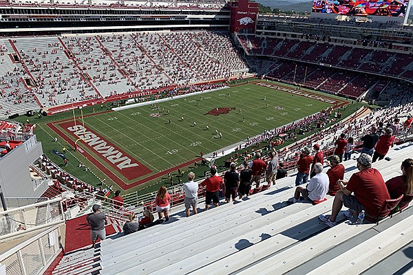 The crowd is shown at kickoff of Arkansas' game against Georgia on Saturday, Sept. 26, 2020, at Reynolds Razorback Stadium in Fayetteville. The crowd size was limited to 16,500 due to covid-19-related restrictions.