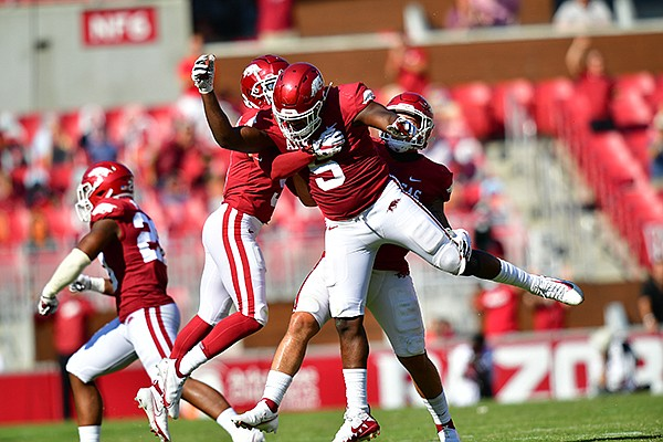 Arkansas defensive end Dorian Gerald (5) celebrates with teammates after recording a sack during a game against Georgia on Saturday, Sept. 26, 2020, in Fayetteville.