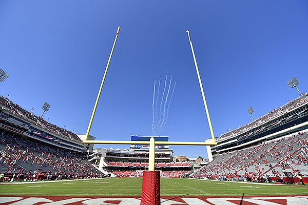 A flight team flies over Donald W. Reynolds Razorback Stadium prior to a game between Arkansas and Georgia on Saturday, Sept. 26, 2020, in Fayetteville. (AP Photo/Michael Woods)
