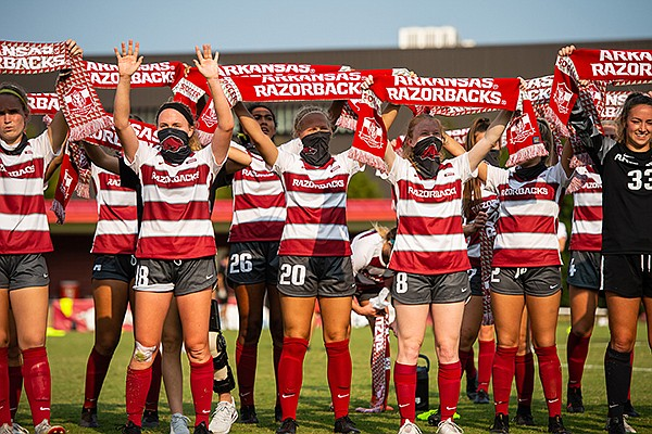Arkansas soccer players take part in a postgame hog call following a 2-0 victory over LSU on Saturday, Sept. 19, 2020, in Fayetteville.