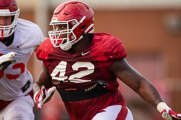 Arkansas defensive lineman Jonathan Marshall makes a move into the backfield during a preseason practice on Sept. 21, 2020 in Fayetteville.