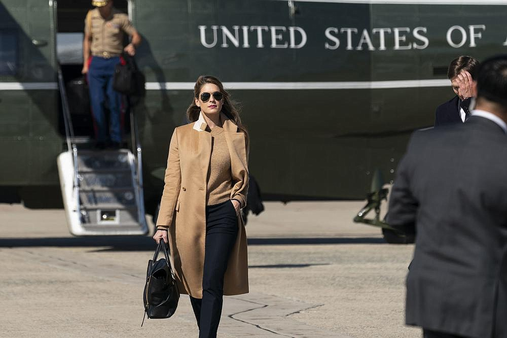 Counselor to the President Hope Hicks walks unmasked from Marine One on Wednesday at Andrews Air Force Base, Md., to accompany President Donald Trump on Air Force One for a campaign trip to Minnesota after also flying with him to the presidential debate on Tuesday.
