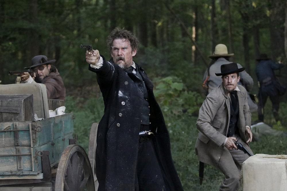 """John Brown (Ethan Hawke) and his son Owen (Beau Knapp) shoot it out with the U.S. Cavalry in a scene from Showtime's miniseries """"The Good Lord Bird,"""" which premieres Sunday."""