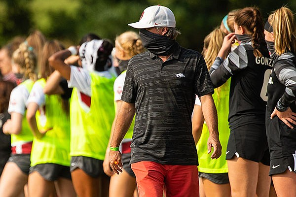Arkansas soccer coach Colby Hale stands in front of his players during a game against LSU on Saturday, Sept. 19, 2020, in Fayetteville.