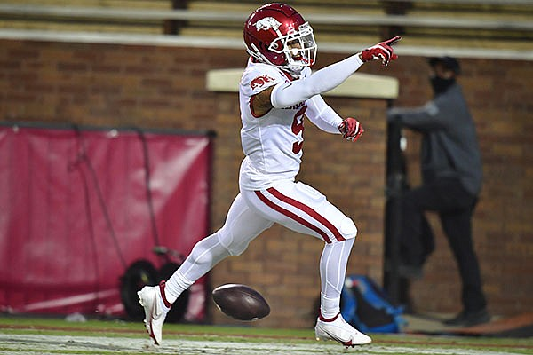 Arkansas cornerback Greg Brooks celebrates after returning an interception for a touchdown during a game against Mississippi State on Saturday, Oct. 3, 2020, in Starkville, Miss.