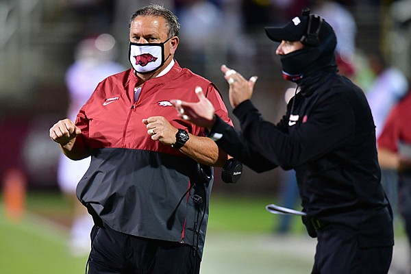 Arkansas head coach Sam Pittman (left) and offensive coordinator Kendal Briles are shown during a game against Mississippi State on Saturday, Oct. 3, 2020, in Starkville, Miss.