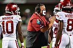 Arkansas coach Sam Pittman talks to players during a game against Mississippi State on Saturday, Oct. 3, 2020, in Starkville, Miss.