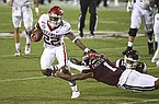Mississippi State cornerback Martin Emerson (1) trips Arkansas running back Trelon Smith (22) during the second half of an NCAA college football game in Starkville, Miss., Saturday, Oct. 3, 2020. Arkansas won 21-14. (AP Photo/Thomas Graning)