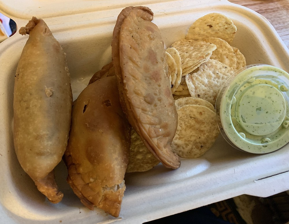 Tren al Sur's empanadas come three to an order, and you can mix and match from among seven options.