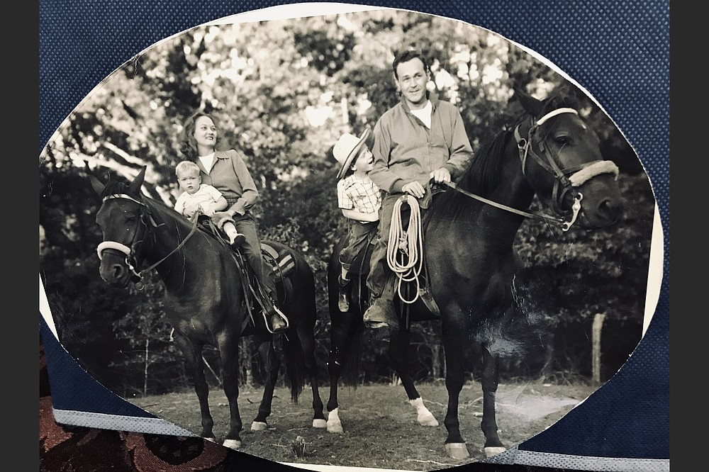 Anne and Sid McMath take their children on a horseback ride near their Hot Springs area home in 1947. Sandy shares a horse with his father, Phillip rides with his mother. (Courtesy of Phillip H. McMath)