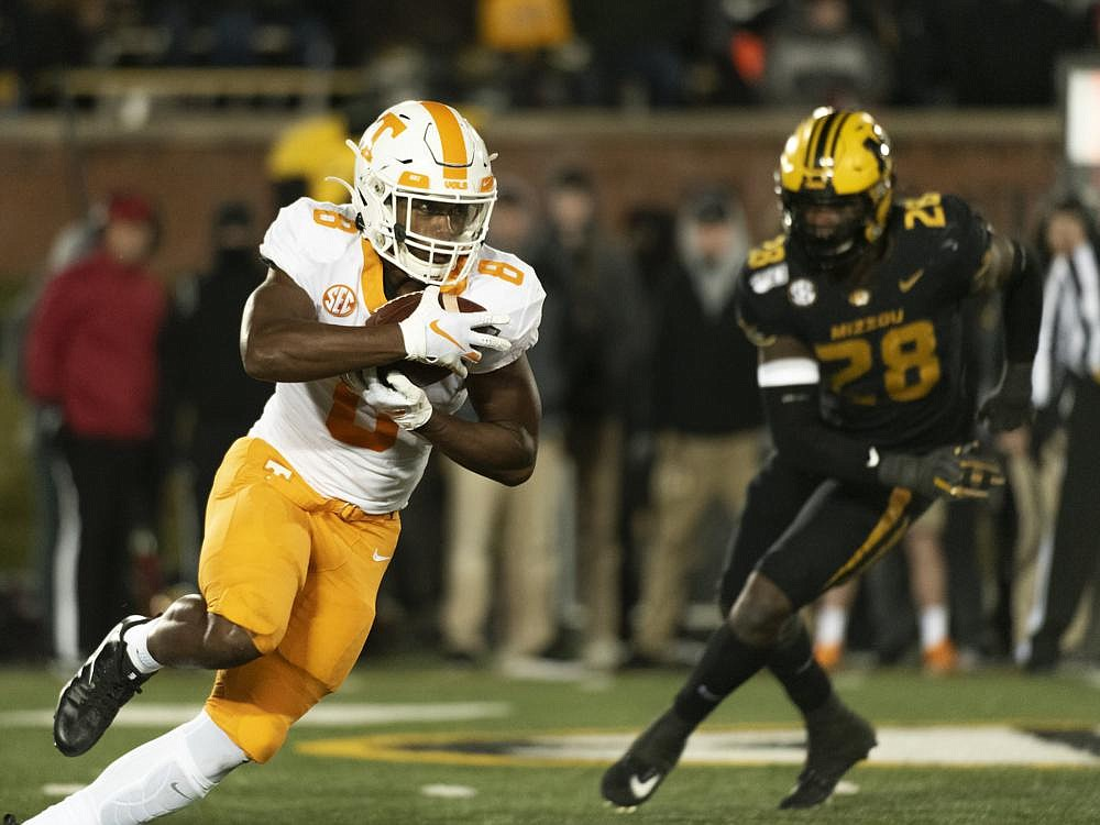 Tennessee running back Ty Chandler (left) has rushed for 176 yards, an average of 5.5 yards per carry, and leads the SEC with 88.0 yards per game. (AP file photo)