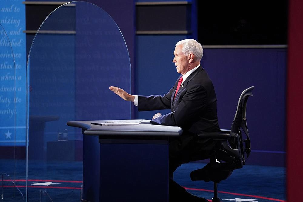 """Vice President Mike Pence asserted during the debate that President Donald Trump """"has put the health of America first,"""" and he defended the administration's efforts to acquire a coronavirus vaccine before the end of the year. (The New York Times/Ruth Fremson)"""