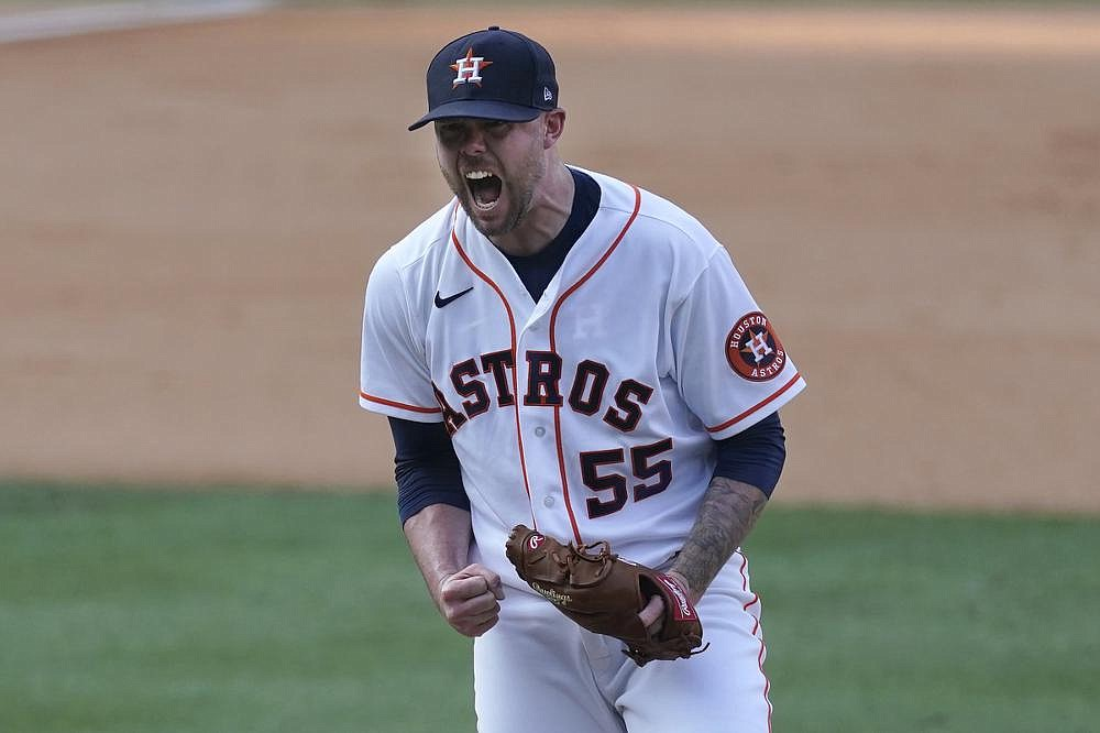 Houston Astros relief pitcher Ryan Pressly (55) reacts after the final out in the Astros' 11-6 victory over the Oakland Athletics in Game 4 of their American League division series Thursday. Houston won the series 3-1. 
