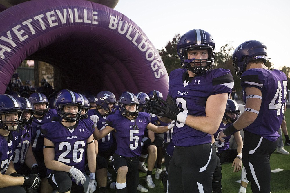 Fayetteville players prepare to take the field, Friday, October 9, 2020 during a football game at Fayetteville High School in Fayetteville. Check out nwaonline.com/2010010Daily/ for today's photo gallery. (NWA Democrat-Gazette/Charlie Kaijo)