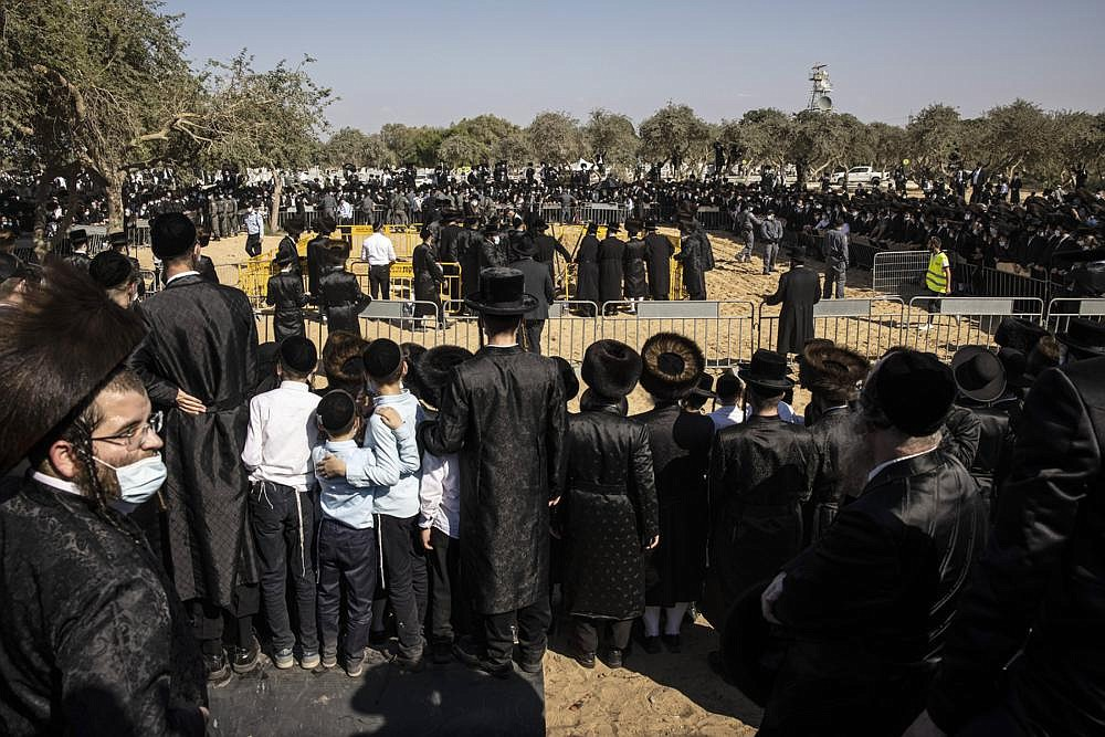 Large numbers of ultra-Orthodox Jews gather Monday for the funeral for Rabbi Mordechai Leifer, in the port city of Ashdod, Israel. After a revered ultra-Orthodox rabbi died this week, Israeli police thought they had worked out an arrangement with his followers to allow a small but dignified funeral that would conform with public health guidelines under the current coronavirus lockdown.