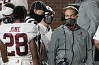 A masked Alabama coach Nick Saban speaks with defensive back Josh Jobe (28) during the second half of the team's NCAA college football game against Ole Miss in Oxford, Miss., Saturday, Oct. 10, 2020. Alabama won 63-48. (AP Photo/Rogelio V. Solis)