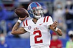 Ole Miss quarterback Matt Corral (2) throws the ball during the second half of an NCAA college football game against Kentucky, Saturday, Oct. 3, 2020, in Lexington, Ky. (AP Photo/Bryan Woolston)
