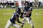 Ole Miss quarterback Matt Corral (2) hands off to running back Snoop Conner (24) during the second half of the team's NCAA college football game against Alabama in Oxford, Miss., Saturday, Oct. 10, 2020. Alabama won 63-48. (AP Photo/Rogelio V. Solis)
