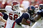 Ole Miss running back Dexter McCluster carries the ball past Arkansas defensive end Damario Ambrose during the second quarter Saturday Oct. 24, 2009, at Vaught-Hemingway Stadium in Oxford, Miss.