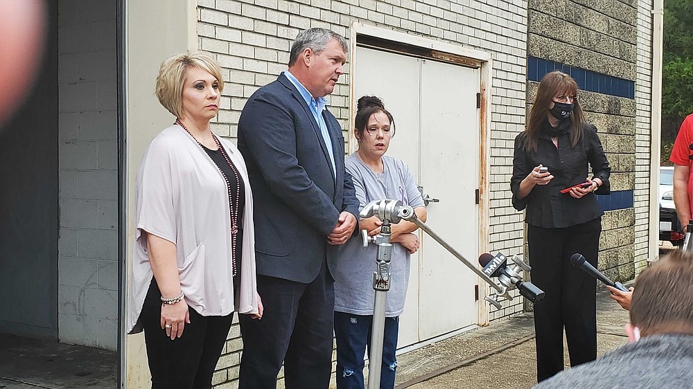 Camden Police Public Information Officer Dana Wetherbee, CPD Chief Boyd Woody and Angela Cannon, the late Alyssa Cannon's mother, await the arrival of Jory Worthen, who is suspected in the murder of Alyssa Cannon and her son Braydon Ponder, Thursday afternoon. Worthen was extradited from California to Camden Thursday. (Bradly Gill/Camden News)