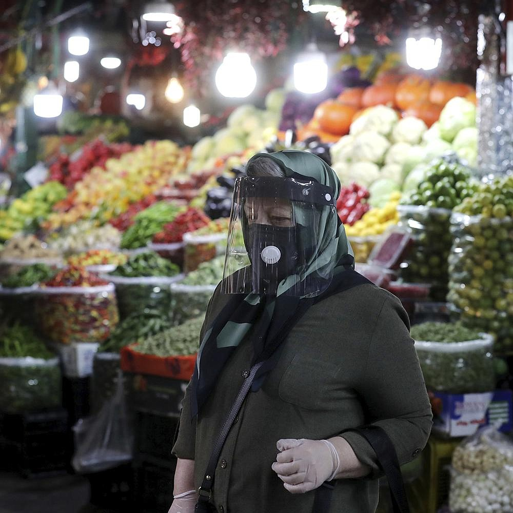 A woman ventures through the Tajrish traditional Iranian bazaar Thursday in northern Tehran. Eight months after the coronavirus pandemic fi rst stormed Iran, authorities appear just as helpless to prevent its spread. More photos at arkansasonline.com/1016virus/. (AP/Ebrahim Noroozi)