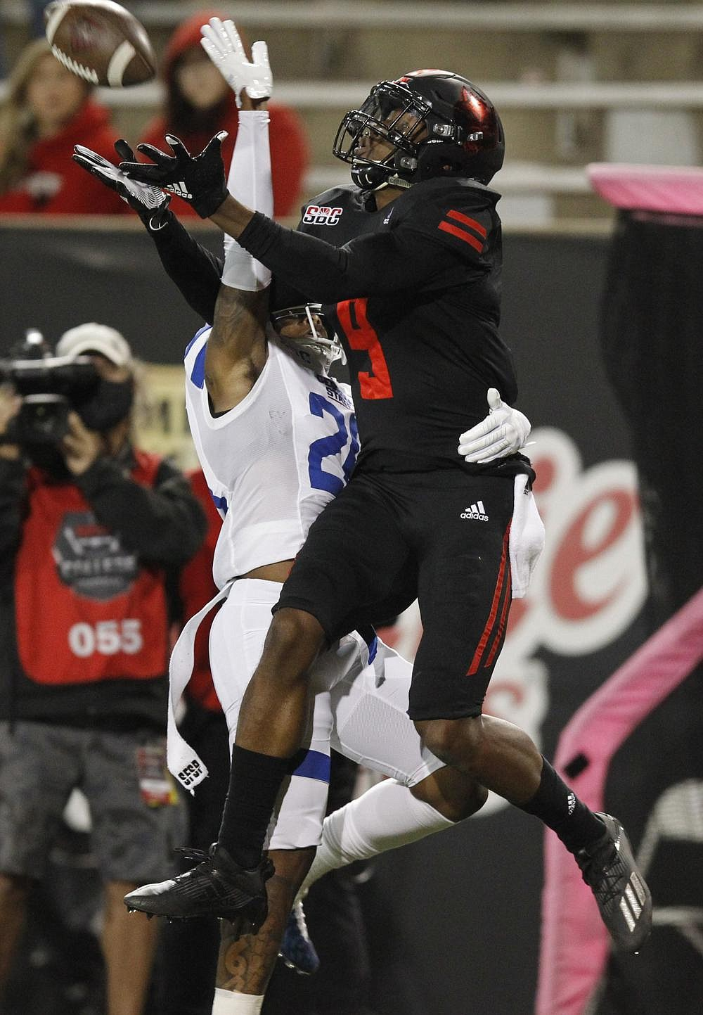 Wide receiver Jonathan Adams Jr. makes the catch on a 42-yard touchdown for Arkansas State while being defended by Georgia State's Quavian White. The Red Wolves had eight touchdown passes during the victory. (Arkansas Democrat-Gazette/Thomas Metthe)