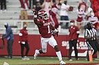 Arkansas safety Jalen Catalon returns an interception for a touchdown during a game against Ole Miss on Saturday, Oct. 17, 2020, in Fayetteville.