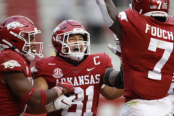 Arkansas linebacker Grant Morgan (31) celebrates after returning an interception for a touchdown during a game against Ole Miss on Saturday, Oct. 17, 2020, in Fayetteville.