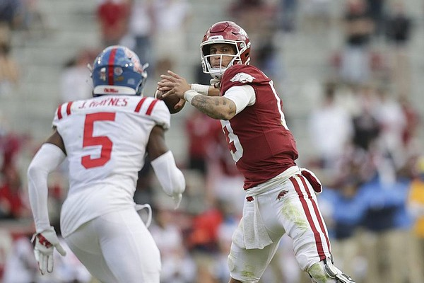 Arkansas quarterback Feleipe Franks (13) throws a pass, Saturday, October 17, 2020 during the fourth quarter of a football game at Donald W. Reynolds Razorback Stadium in Fayetteville. Check out nwaonline.com/201018Daily/ for today's photo gallery.  (NWA Democrat-Gazette/Charlie Kaijo)