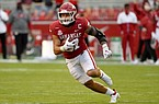Arkansas linebacker Grant Morgan (31) returns an interception for a touchdown against Mississippi during the second half of an NCAA college football game Saturday, Oct. 17, 2020, in Fayetteville, Ark. (AP Photo/Michael Woods)