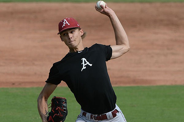 Arkansas pitcher Caden Monke delivers to the plate Friday, Sept. 18, 2020, during practice at Baum-Walker Stadium in Fayetteville.