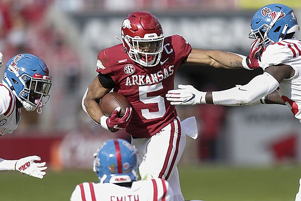Arkansas running back Rakeem Boyd carries the ball during a game against Ole Miss on Saturday, Oct. 17, 2020, in Fayetteville.