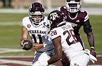 Texas A&M quarterback Kellen Mond (11) hands off to running back Isaiah Spiller (28) during the first half of an NCAA college football game against Mississippi State in Starkville, Miss., Saturday, Oct. 17, 2020. (AP Photo/Rogelio V. Solis)