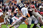 Arkansas linebacker Hayden Henry upends Auburn quarterback Bo Nix for a sack on Oct. 10, 2020 in Auburn, Ala.