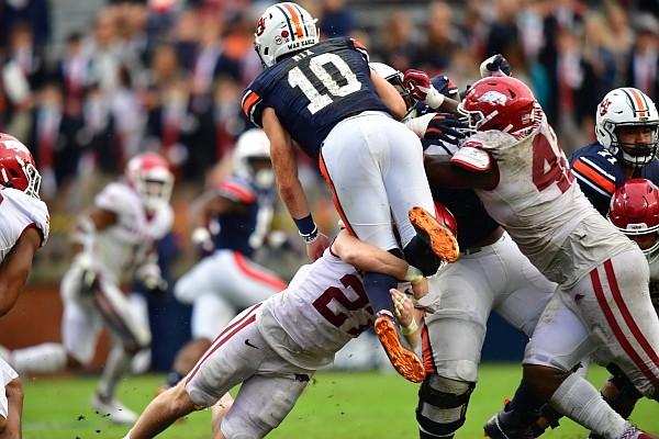 Arkansas linebacker Hayden Henry upends Auburn quarterback Bo Nix for a sack on Oct. 10, 2020 in Auburn, Ala.